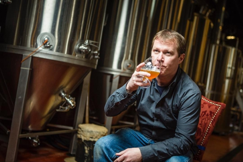 Michael Carroll, Head Brewer, with his brewpub's PKW Fermenters